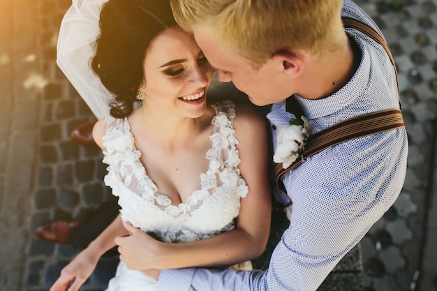 Top view of newlyweds laughing and hugging Free Photo