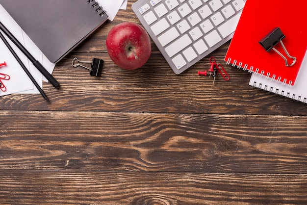Top view of notebook and keyboard on wooden desk Free Photo