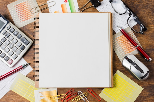 Top view notebook on office material Free Photo