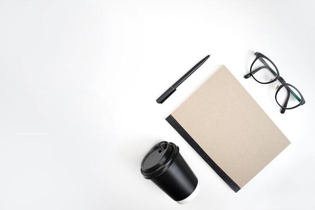Top view, notebook, pen, eye glasses Premium Photo