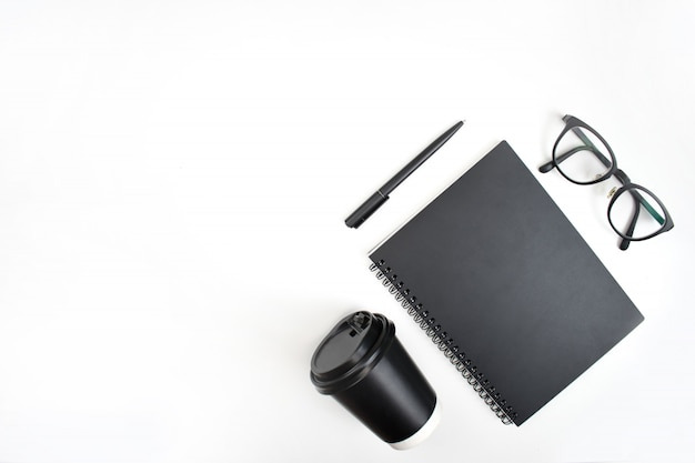 Top view of notebook, pen, eye glasses Premium Photo