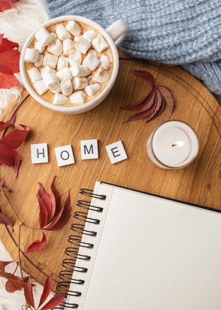 Top view of notebook with cup of hot cocoa with marshmallows Free Photo
