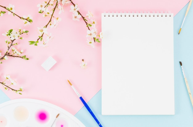 Top view notebook with floral branches Free Photo