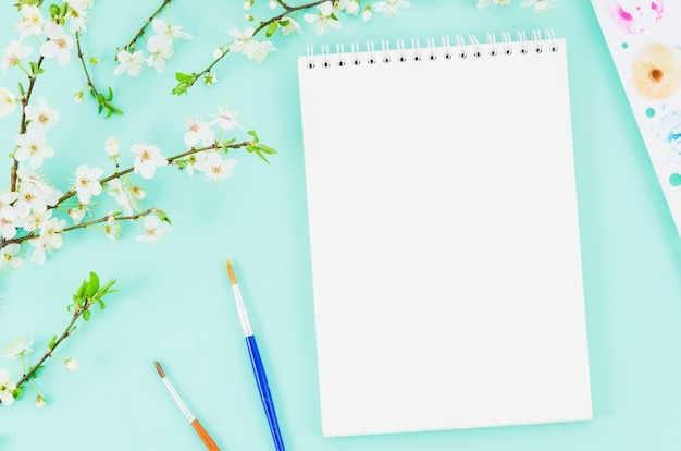 Top view notebook with flower branch Free Photo