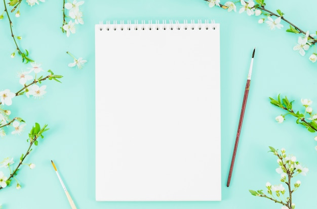 Top view notebook with flower branches Free Photo
