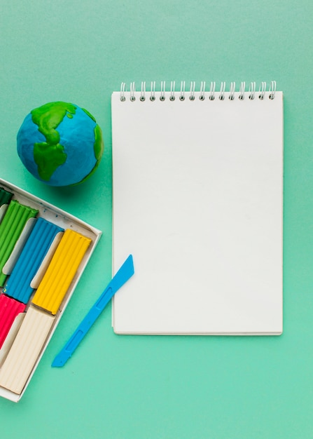 Top view of notebook with globe Free Photo