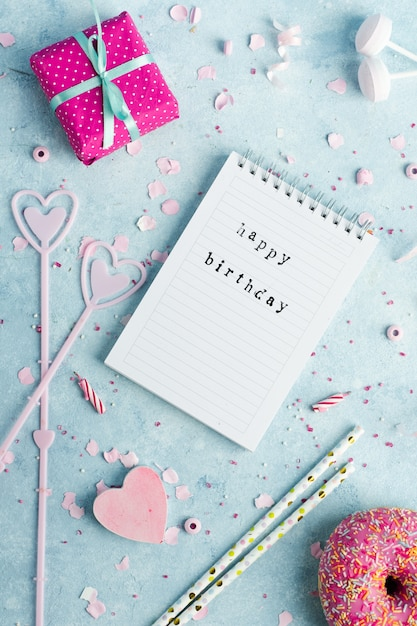 Top view of notebook with happy birthday wish and present Free Photo