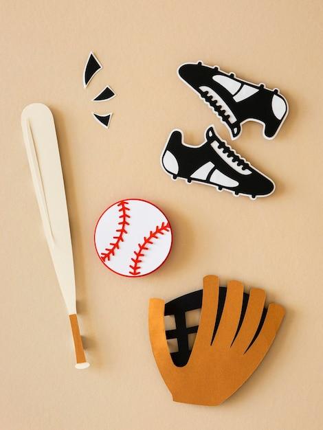 スニーカーとグローブと野球のバットの上面図 無料写真