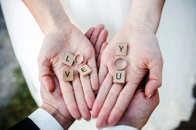 top view of brides hands with the wedding rings free photo - Wedding Rings On Hands
