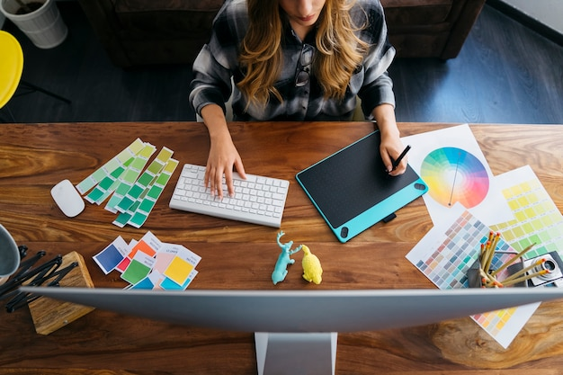 Top view of graphic designer working Free Photo