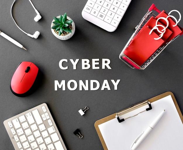 사이버 월요일에 대한 쇼핑 카트 및 계산기가있는 메모장의 상위 뷰 무료 사진