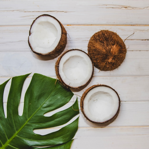 Top view of palm leaf and coconuts Free Photo