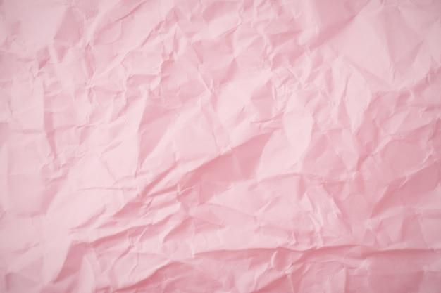 핑크 구겨진 된 종이 배경의 최고 볼 수 있습니다. 프리미엄 사진