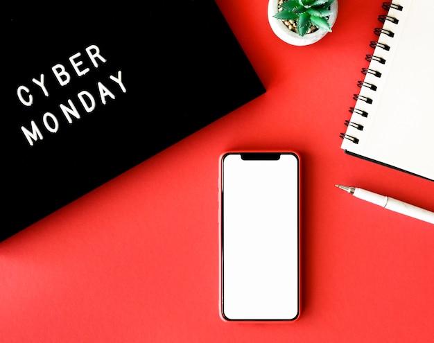 사이버 월요일에 대한 공장 및 노트북이있는 스마트 폰의 상위 뷰 무료 사진