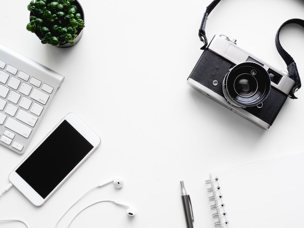Top view of office desk workspace notebook, plastic plant, graphic tablet on white background with copy space, graphic designer, creative designer concept. Premium Photo