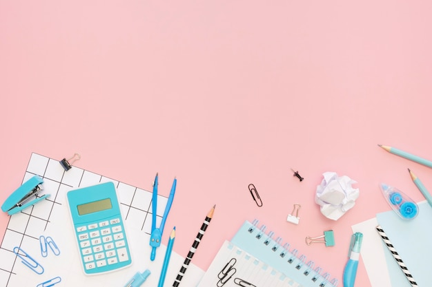 Top view of office stationery with calculator and copy space Free Photo