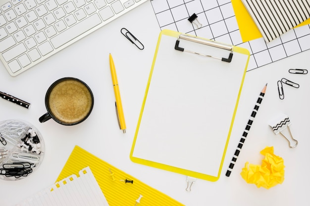 Top view of office stationery with notepad and coffee Premium Photo