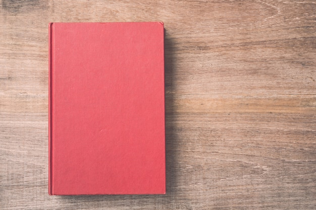 Top view old book on wooden plank background Premium Photo