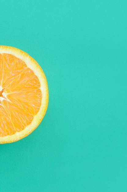 Top view of a one orange fruit slice on bright background Premium Photo