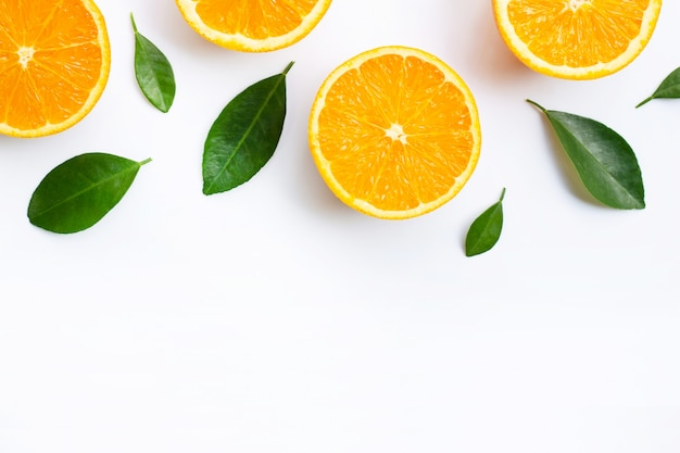 Top view of orange fruits and leaves isolated on white background. Premium Photo