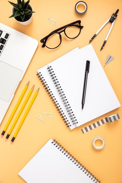 Top view organised arrangement of desk elements on orange background Free Photo