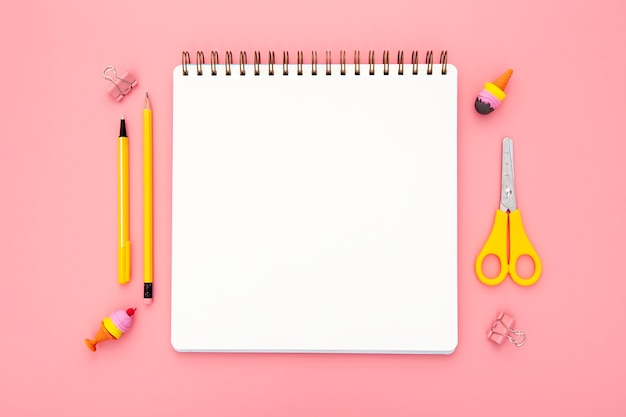 Top view organised arrangement of desk elements on pink background Free Photo