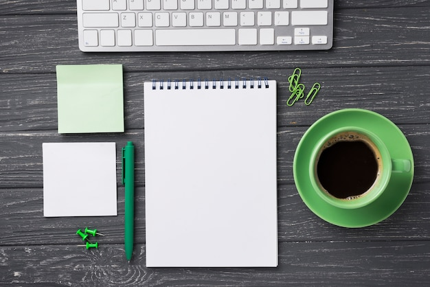 Top view of organized desk with coffee cup and sticky notes Free Photo