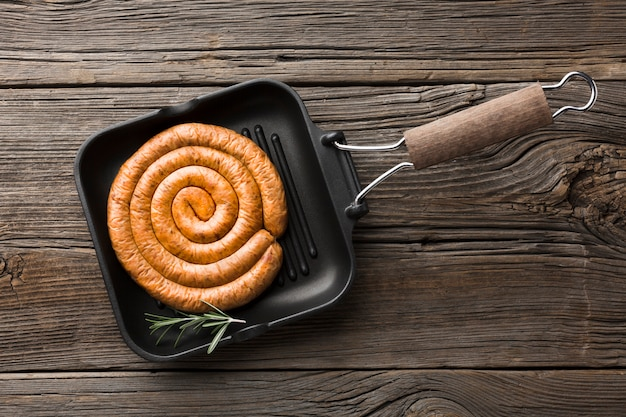 Top view pan with delicious grill sausage Free Photo