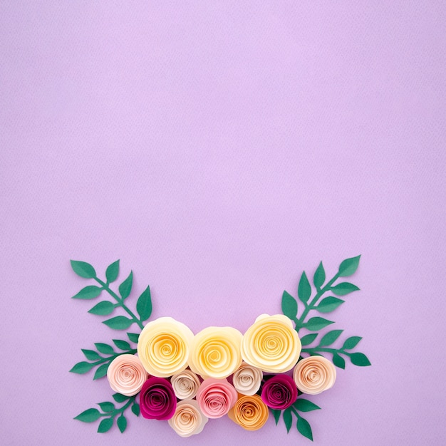 Top view paper flowers and leaves on purple background Free Photo