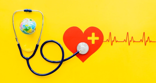 Top view of paper heart with heartbeat and stethoscope Free Photo