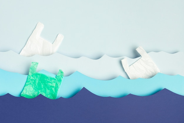 Top view of paper ocean waves with plastic bags Free Photo