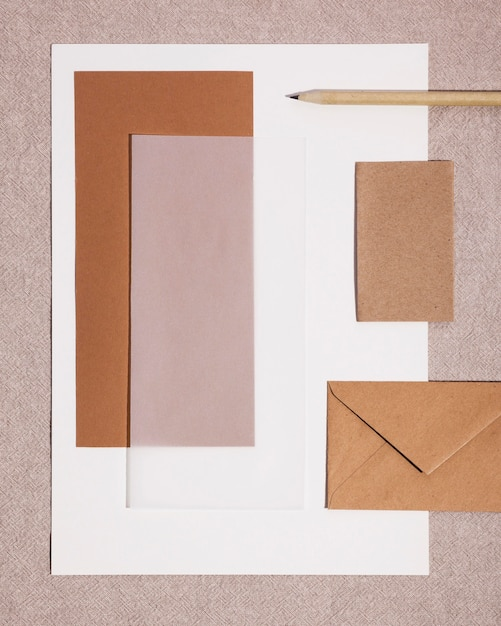 Top view paper office supplies on desk Free Photo
