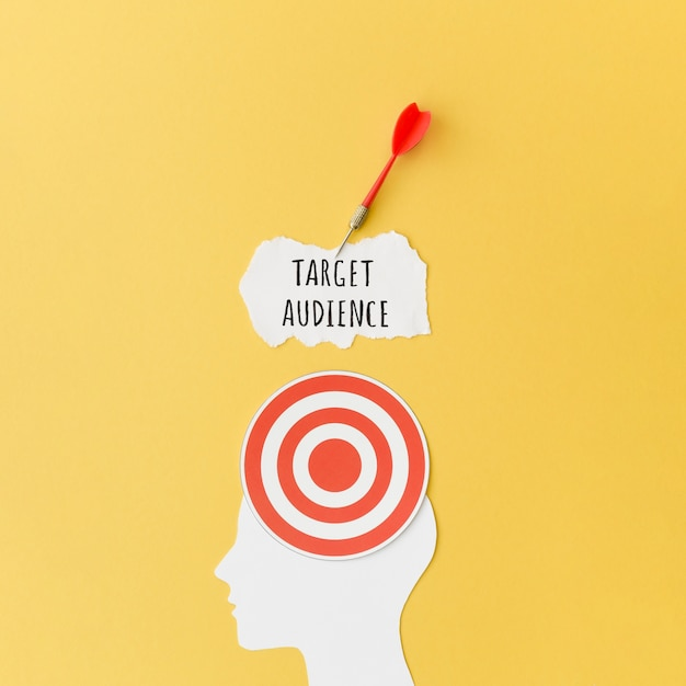 Top view of paper target on silhouette and dart Free Photo