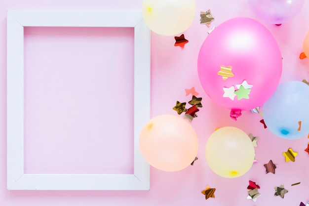 Top view party balloons and frame Free Photo