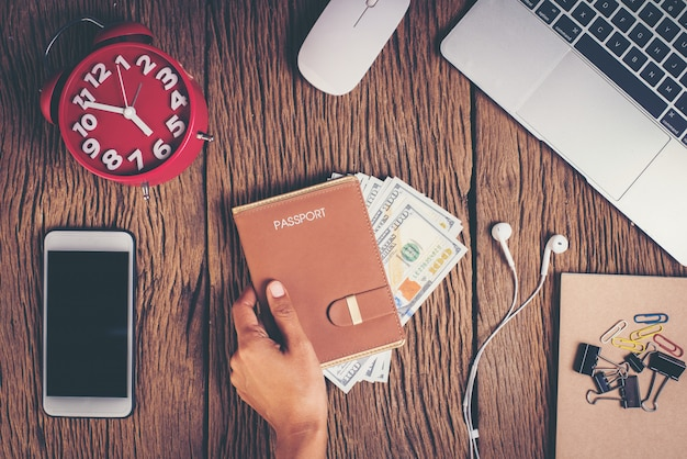 Top view passport with money on workspace, tourism concept Free Photo