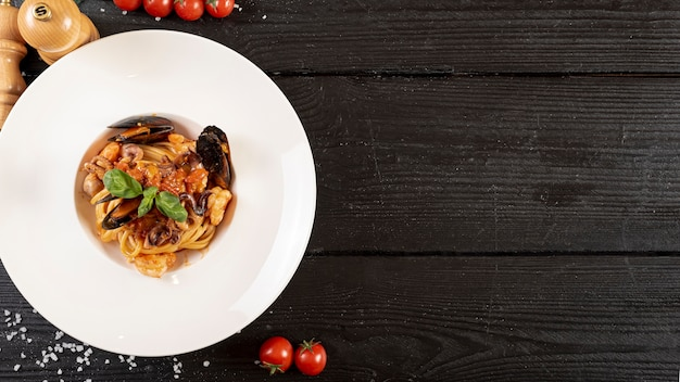 Top view of pasta and seafood on wooden table Free Photo