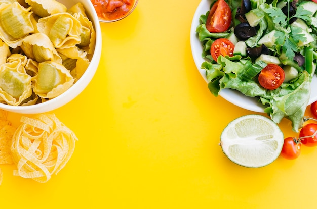 Top view pasta vs salad Free Photo