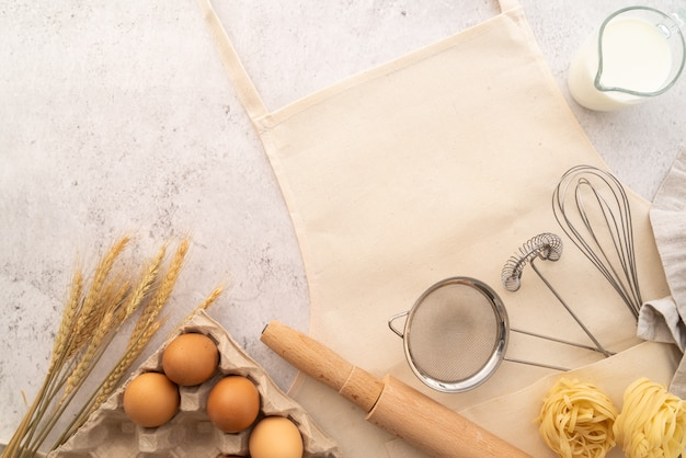 Top view pasta with ingredients frame with apron Free Photo