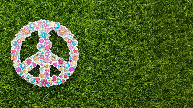Top view of peace sign on grass with copy space Free Photo