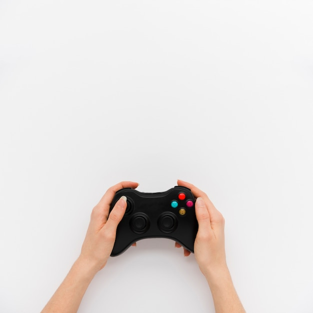 Top view person holding a controller Free Photo