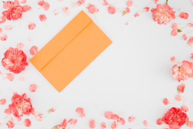 Top view petals frame with envelope Free Photo