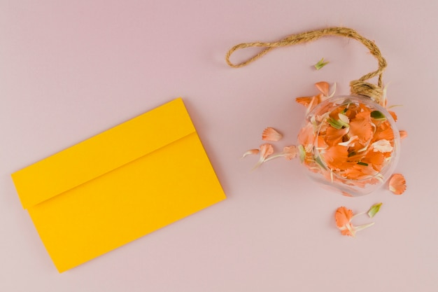 Top view petals with envelope Free Photo