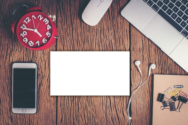 Top view phone and workspace on wood background Free Photo