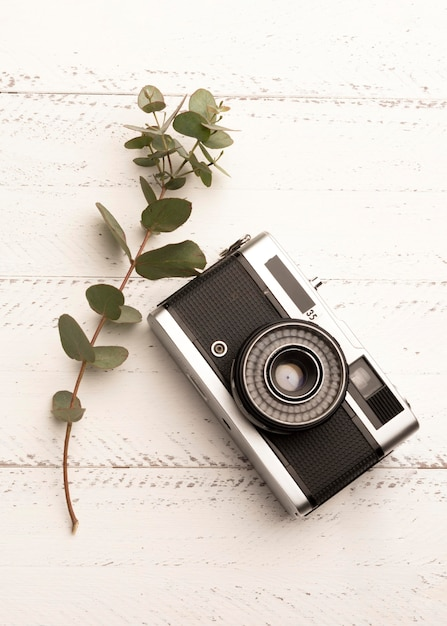 Top view photo camera on wooden table Free Photo