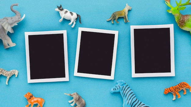 Top view of photos with animal figurines for animal day Free Photo