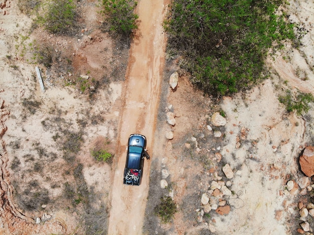Top view pick up truck off road with load bike Premium Photo