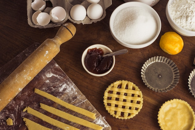 Top view pie dough preparation Free Photo