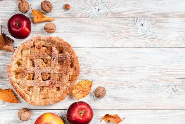 Top view of pie surrounded by apples Free Photo