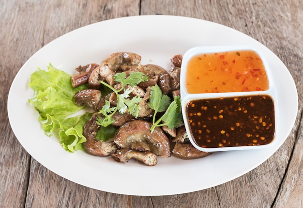 Top view pig's intestines grilled thai style food Premium Photo
