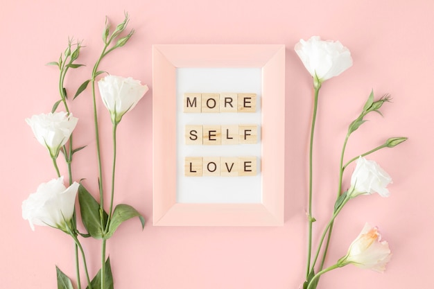 Top view pink frame and flowers arrangement Free Photo